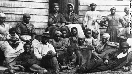 A portrait of Civil War-era fugitive slaves who were emancipated upon reaching the North in the mid-1860s.