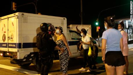 Relatives of inmates wait for news as a coroners truck arrives to the Litoral penitentiary after a riot, in Guayaquil, Ecuador, Tuesday, Sept. 28, 2021.