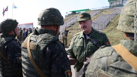 Lukashenko, here with troops near the Polish and Ukrainian borders, paints himself as a strongman.