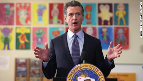Governor says California becomes first US state to require COVID-19 vaccination for students