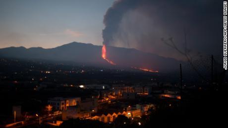 Cumbre Vieja volcano spews lava, ash and smoke over Los Llanos de Ariadne on the Canary Islands of La Palma on Sunday.