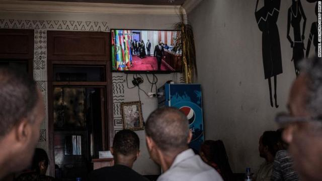 People watch the swearing-in ceremony at a coffee shop in the capital Addis Ababa.