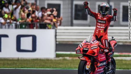 Bagania celebrates after winning the San Marino MotoGP Grand Prix.