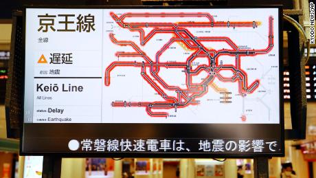The status of the train services delayed by the earthquake are seen on a monitor at JR Tokyo station.
