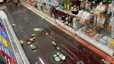Items lay on the ground at a convenience store in Tokyo on October 7, 2021.