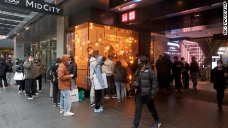 Customers line up to enter a store in Sydney on October 11, after more than 100 days of lockdown.