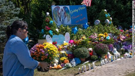 Members of the public leave flowers at a memorial site for Gabby Petito, September 26, 2021 in Blue Point, Long Island, New York.