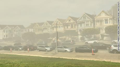 ThisClimateDoesNotExist uses AI to show what places can look like due to climate change;  here is a Google Street View image of San Francisco's & quot;  Painted Ladies & quot;  home is depicted by technology as enclosed by smog.