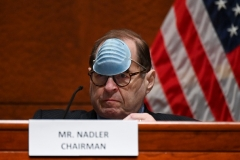 """Rep. Jerry Nadler (D-N.Y.) lifts his mask to sip some water at a markup of the """"Justice in Policing Act"""" on June 17. (Photo by ERIN SCOTT/POOL/AFP via Getty Images)"""