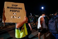 A protester holds a placard during a demonstration against the shooting of Jacob Blake in Kenosha, Wisconsin on August 26, 2020. (Photo by KAMIL KRZACZYNSKI/AFP via Getty Images)