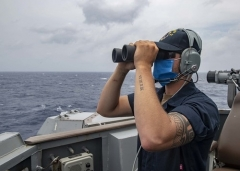 A U.S. Navy sailor on the on the bridge wing of the guided missile destroyer USS Mustin in the South China Sea on Thursday. (Photo: U.S. Navy/MC3 Cody Beam)