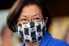 Sen. Mazie Hirono (D-Hawaii) wears a mask depicting former Supreme Court Justice Ruth Bader Ginsburg at the Oct. 12 hearing for Supreme Court nominee Judge Amy Coney Barrett. (Photo by LEAH MILLIS/POOL/AFP via Getty Images)