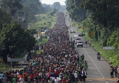 President Trump blocked aid to Central American countries because of scenes such as this caravan making its way to the Southwest border. (Photo by John Moore/AFP via Getty Images)