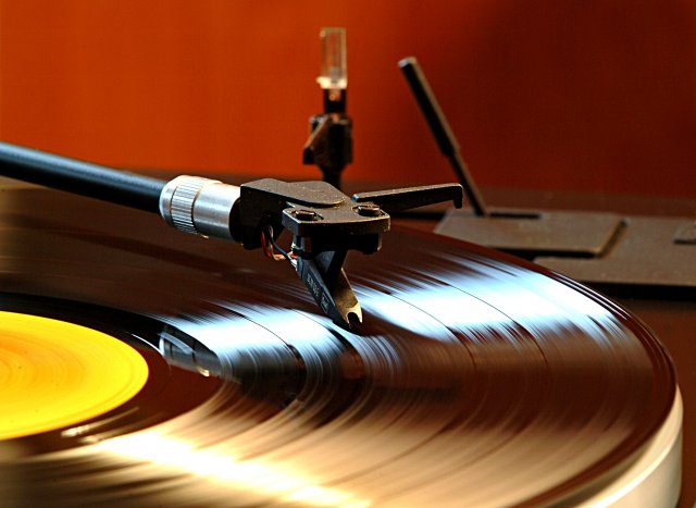 Image of a record on a turntable.