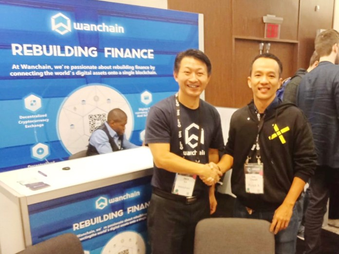 A Pundi X representative with a Wanchain representative. A partnership was forged this year at Consensys 2018 in New York City.