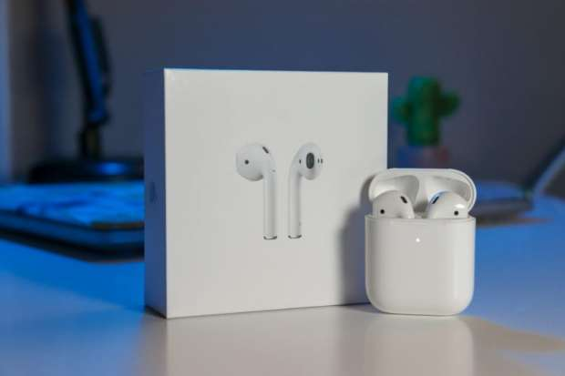 AirPods 2 with box on desk
