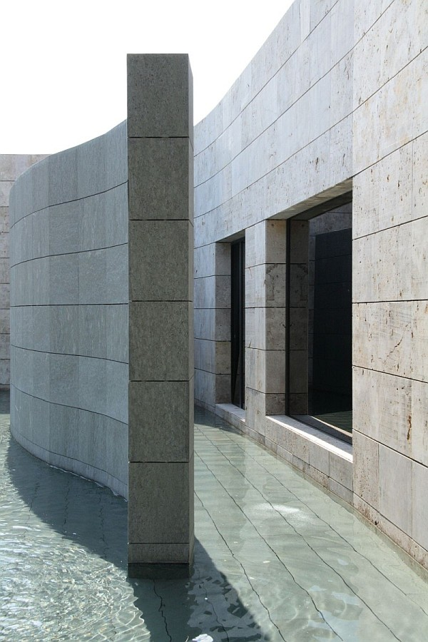 Spanish Home Clad In Dark Stone Assures Privacy And Serenity