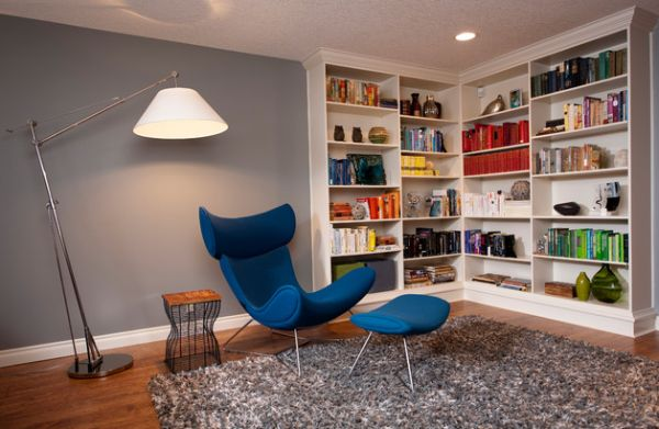Contemporary family room with a stylish bookcase in the corner 15 Corner Wall Shelf Ideas To Maximize Your Interiors