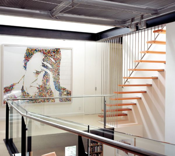 Interesting art work and lovely floating stairs combine to give this home a chic look