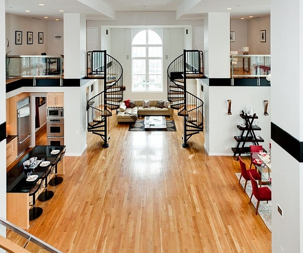 Amplia sala de estar con escaleras de caracol gemelas y entrepisos