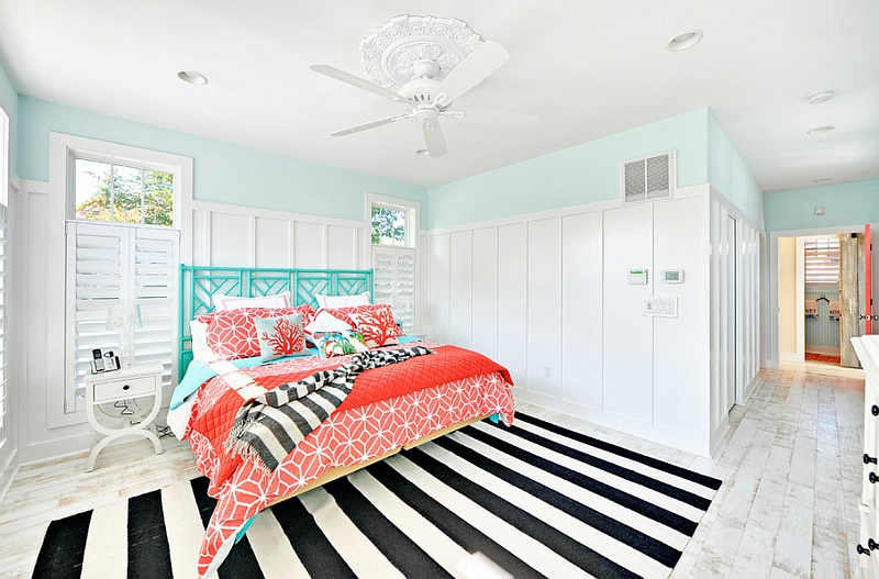 Beach style bedroom with a striped rug and fabulous coral and aqua accents Hot Color Trends: Three Fashionable Hues That Serve You All Year Long Year Trends Three Serve Long Hues Fashionable Color