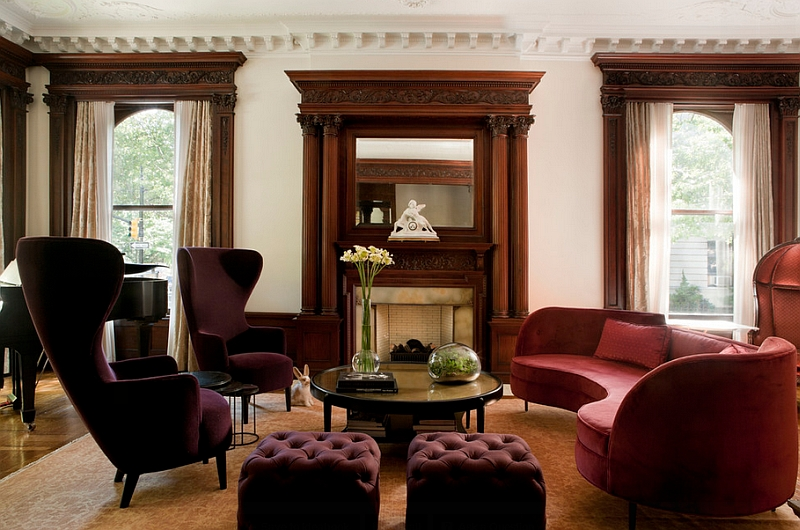 Curved sofa coupled with Tom Dixon wingback chairs in eggplant and plush ottomans Hot Color Trends: Three Fashionable Hues That Serve You All Year Long Year Trends Three Serve Long Hues Fashionable Color