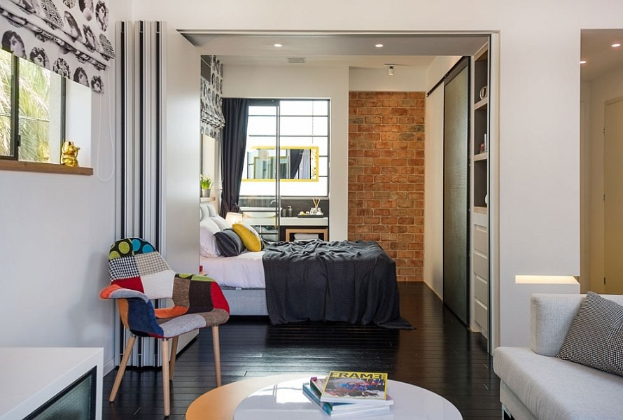 Smart Modern Renovation Transforms Small Urban Apartment View in gallery Stackabale dividers for the small urban bedroom