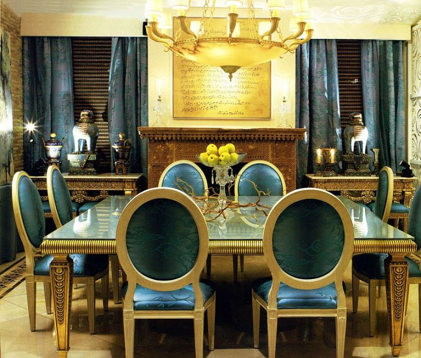 Dazzling dining room in blue and gold with custom drapes and decor [Design: Coleccion Alexandra]