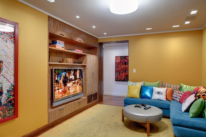 Bright L Shaped Couch In Blue With Colorful Accent Pillows For The Tv Room