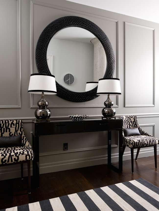 Black And White Entryway With Large Round Mirror