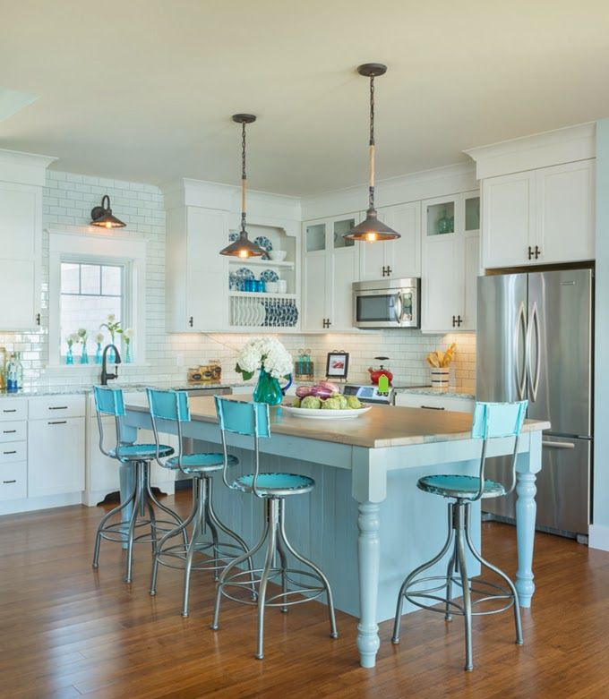 18 Brilliant Kitchen Bar Stools That Add a Serious Pop of Color View in gallery Bright blue bar stools that go with the kitchen island