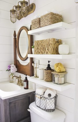 15 Exquisite Bathrooms That Make Use of Open Storage     in gallery Country bathroom with shelves installed above toilet