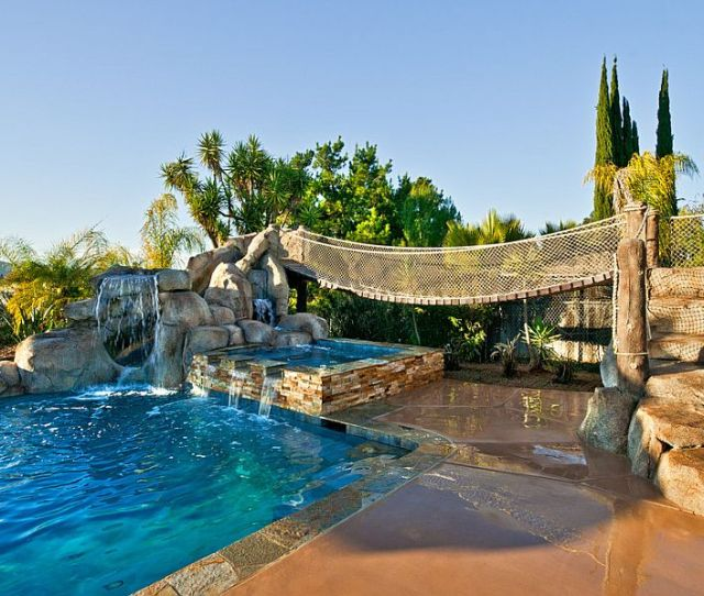 Expansive Pools With Waterfalls Are Perfect For The Tropical Backyard Design Distinguished Pools