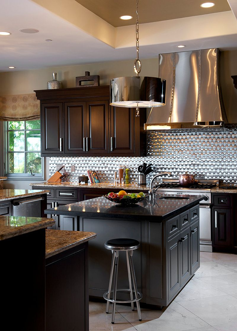 Bright metallic backsplash and hood draw your attention instantly [Design: Dora Brigham Interiors]