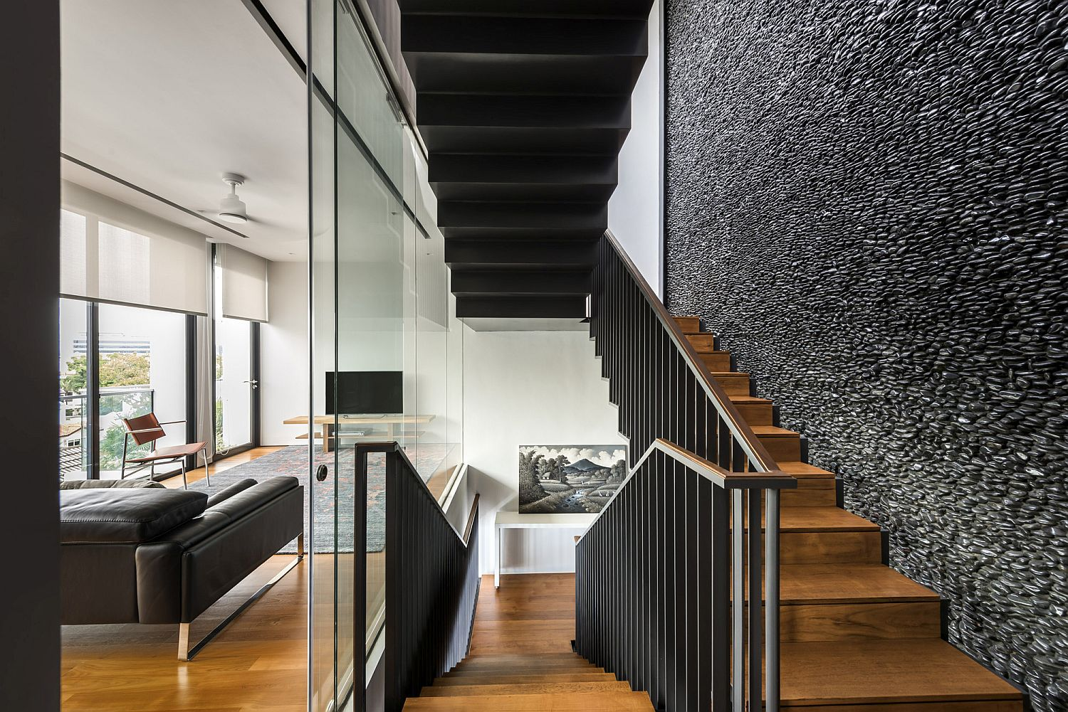 Polished Feature Wall With Black River Pebbles Captivates