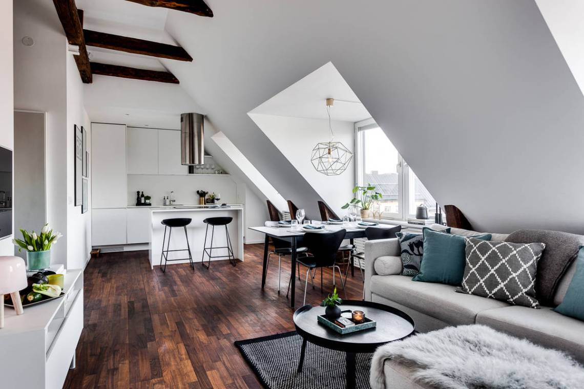 Kitchen At The End Of Open Plan Living Space Inside Small Attic Apartment