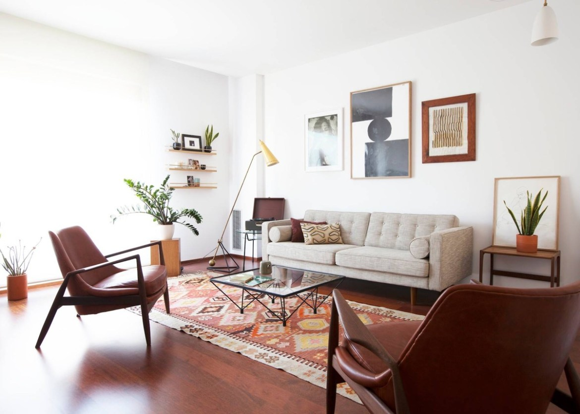 living room with large leather chairs and geometric bohemian rug