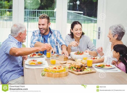 Happy Multi Generation Family Having Food Dining Table