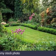 High Meadow Surrey Formal Boxwood Edged Oval Lawn Late