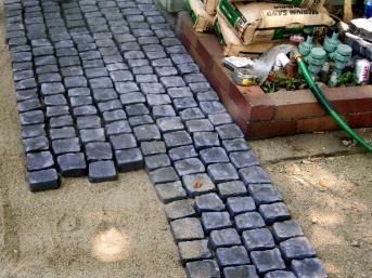 Install Cobblestone Patio Concrete Bare