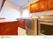 Laundry Room Modern Steel Appliances Stock
