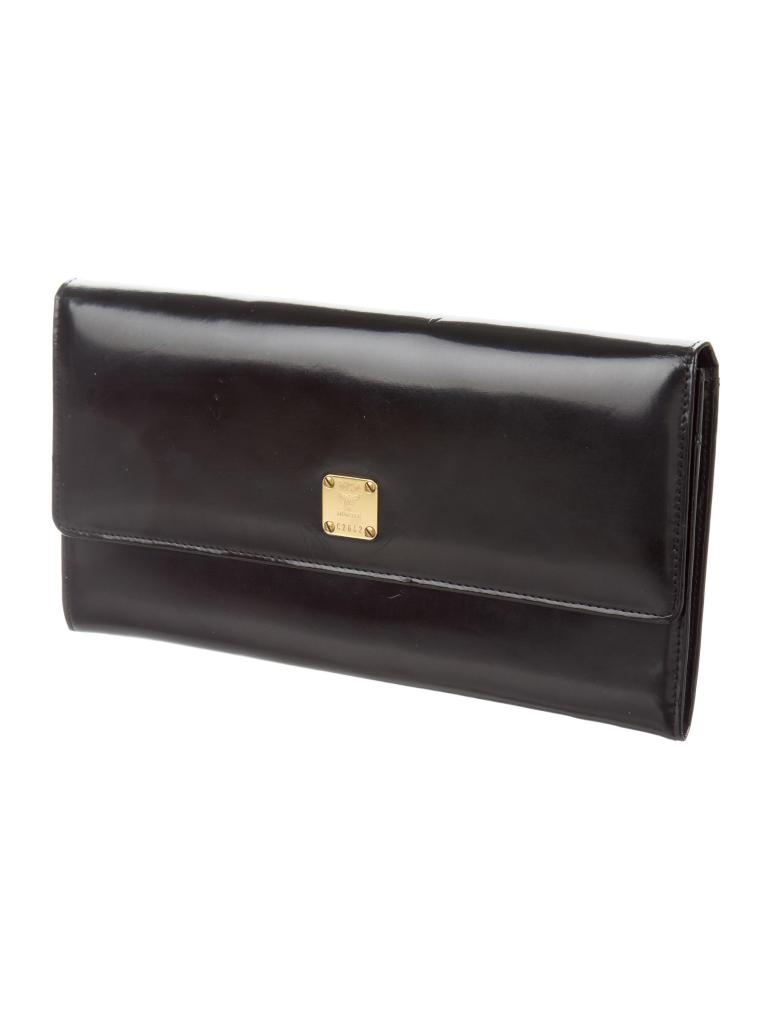 Mcm Leather Flap Clutch Handbags W Realreal