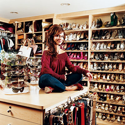 closets - cabinets shoes belts sunglasses  Paula Abdul's walk-in closet  Look at all the shoe storage!!!!!!
