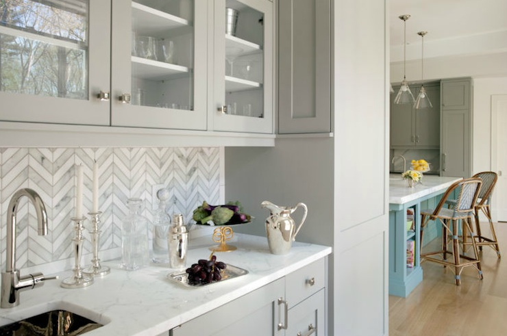 Butler's Pantry With Herringbone Backsplash And Gray Glass