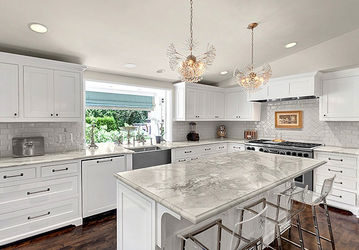 white kitchen cabinets with marble