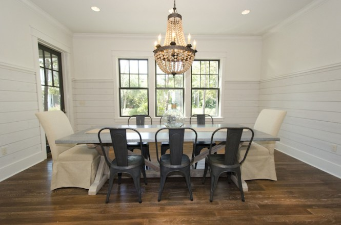 Chic Dining Room Features Pottery Barn Wood Bead Chandelier Over Restoration Hardware Salvaged Weathered Concrete X Base Table Lined By Tolix Chairs
