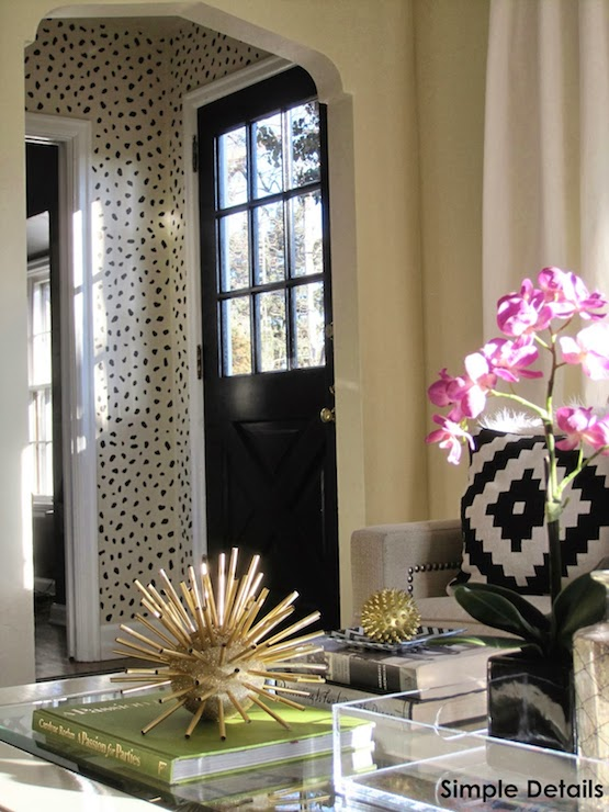 Simple Details - living rooms - Cheetah Spots wall Stencil, gold sea urchin, sea urchin decor, coffee table vignette, coffee table styling, styled coffee table, pink orchid, lucite tray, black front door, black glass paned front door, black and white geometric pillow, cheetah spots stencil, animal print walls, animal print stencil, cheetah print stencil, cheetah print walls, black cheetah spot walls, black doors, black interior doors, cheetah stencil,