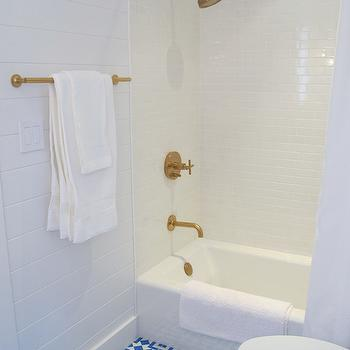 white bathroom with gold fixtures
