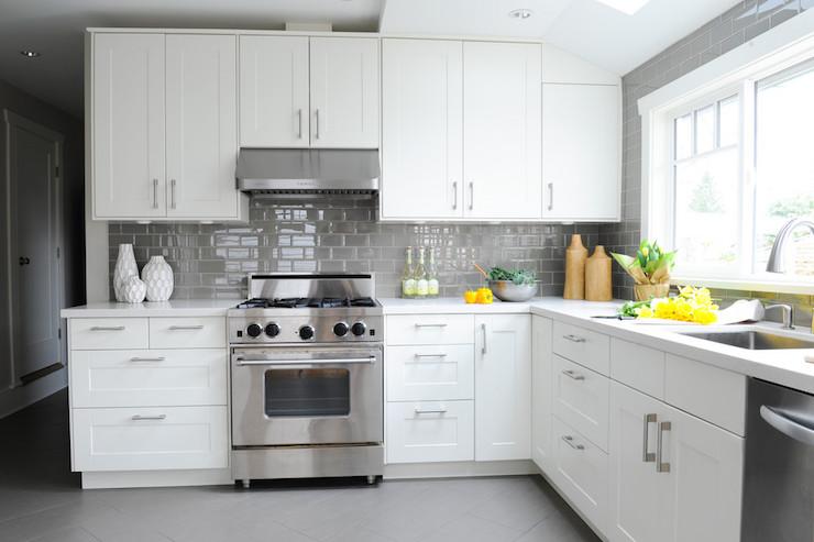 white kitchen with grey subway tiles