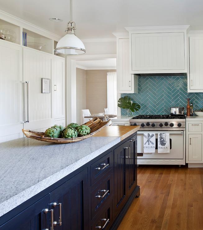 turquoise herringbone tile backsplash